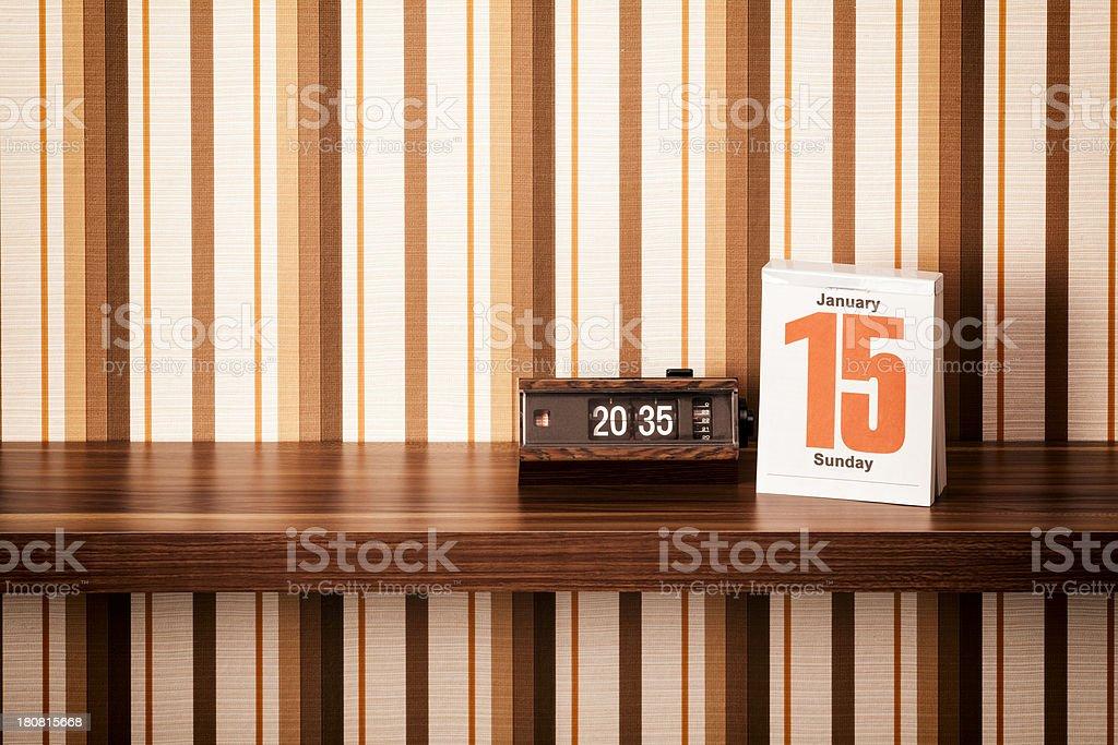 Retro style alarm clock and calendar on shelf royalty-free stock photo