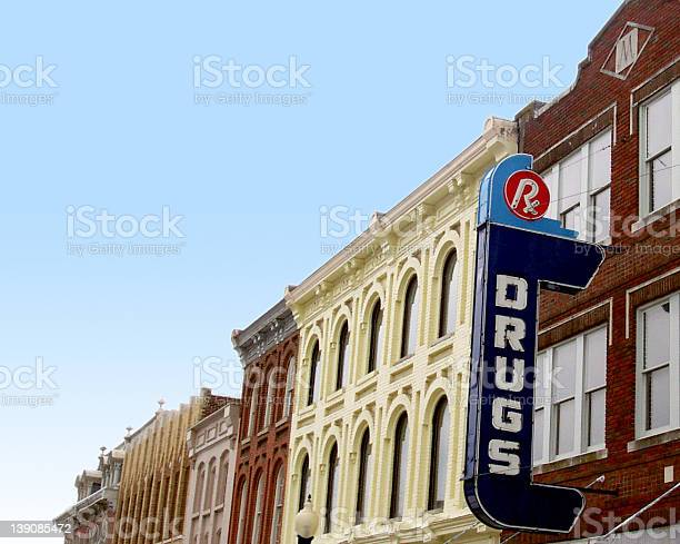 Retro style American drug store sign on vintage buildings A row of old storefronts, including a sign for a drugstore. (Franklin, TN) Downtown District Stock Photo
