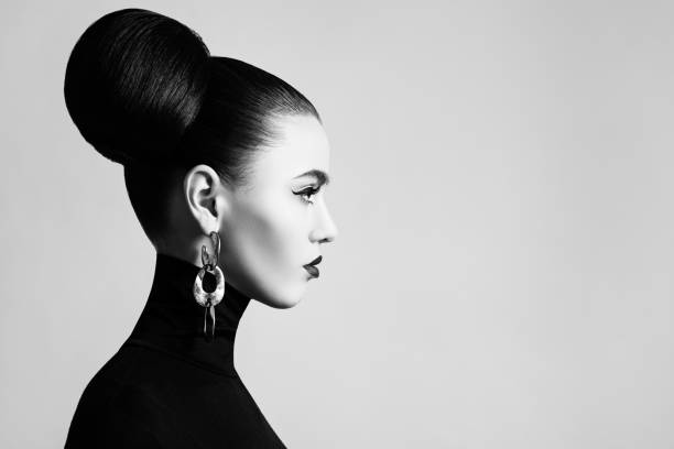 retro style black and white fashion portrait of elegant female model with hair bun hairstyle and eyeliner makeup - makeup fashion stock pictures, royalty-free photos & images