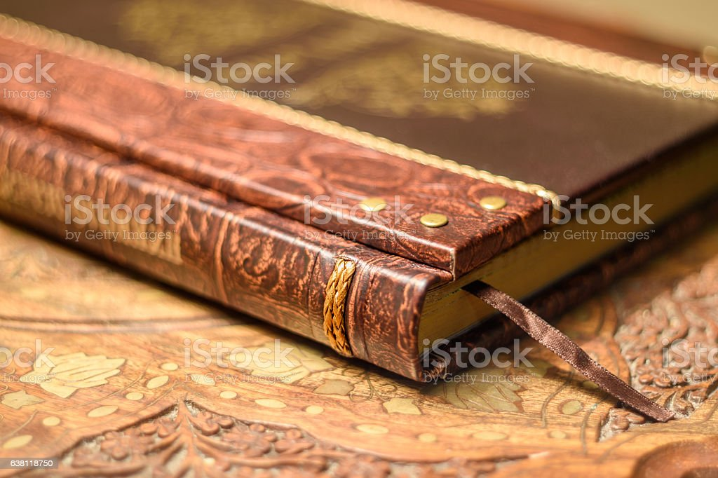 Retro style book with the silk laying. Handmade leather cover. stock photo