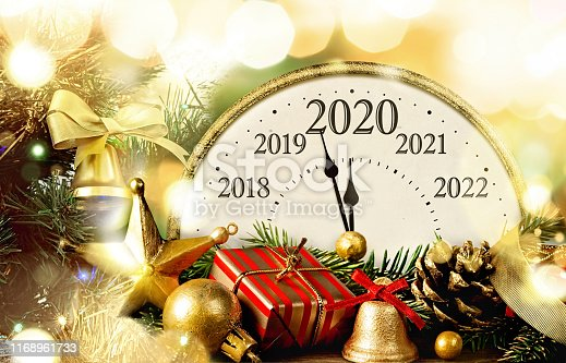 New Year's Eve. Retro style clock with christmas decorations. Happy new year 2020.