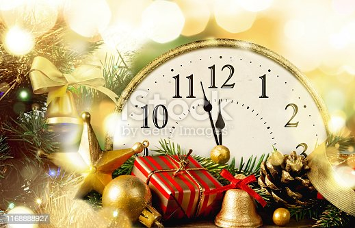 istock Retro style clock with christmas and new year decorations. 1168888927