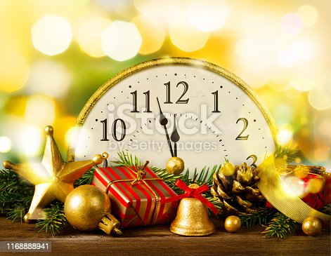 istock Retro style clock with christmas decorations. 1168888941