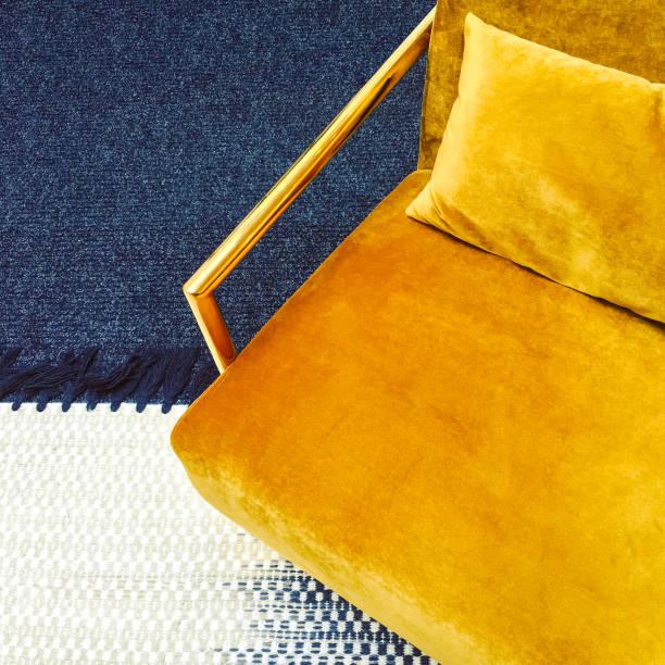 Retro style dark yellow velvet armchair stock photo