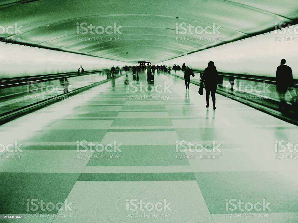 Retro Style Detroit Airport Tunnel with silhouettes of People Walking stock photo