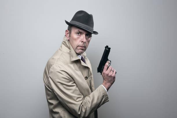 Retro style gangster with handgun stock photo