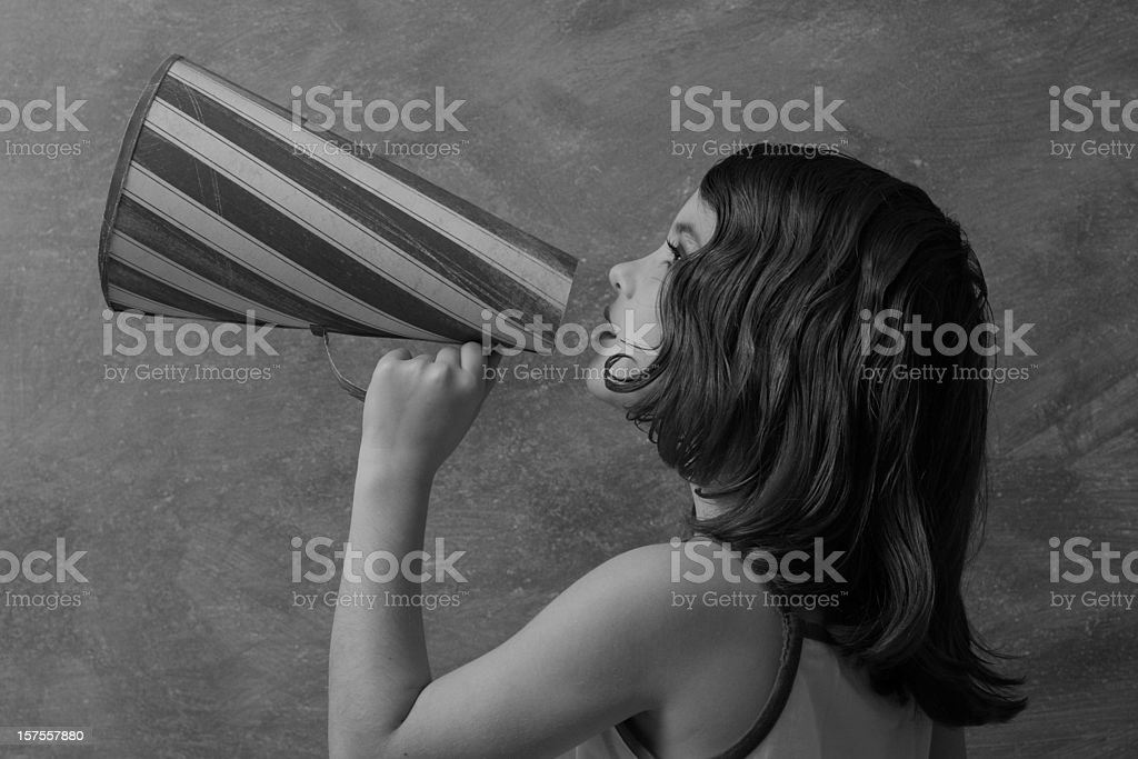 Retro style girl with megaphone royalty-free stock photo