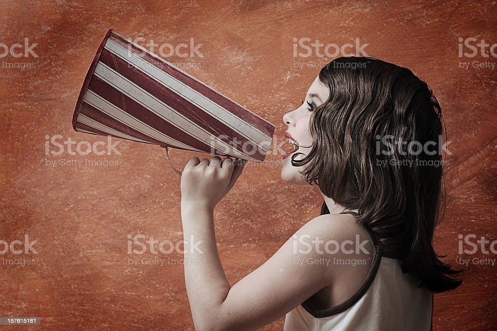 Retro style girl with megaphone stock photo