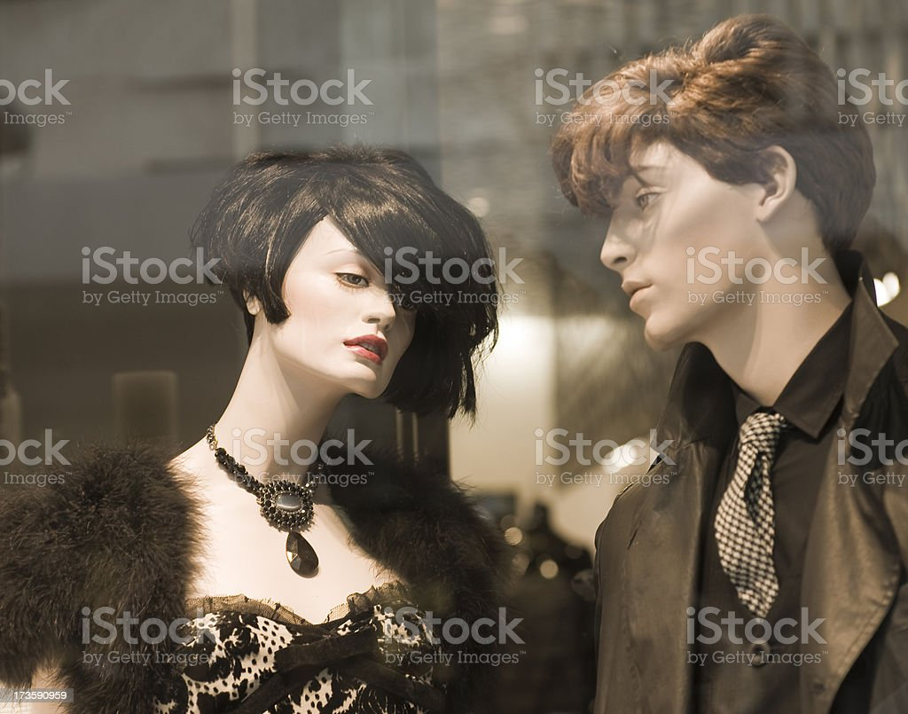Retro style mannequins in shop window royalty-free stock photo