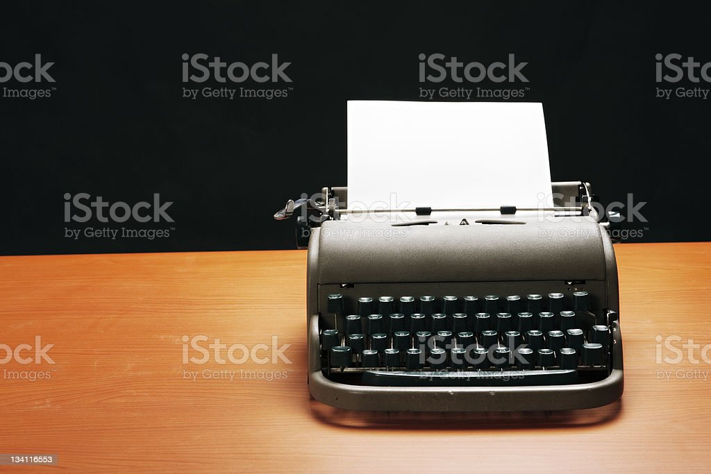 Retro style manual typewriter with blank sheet of paper royalty-free stock photo
