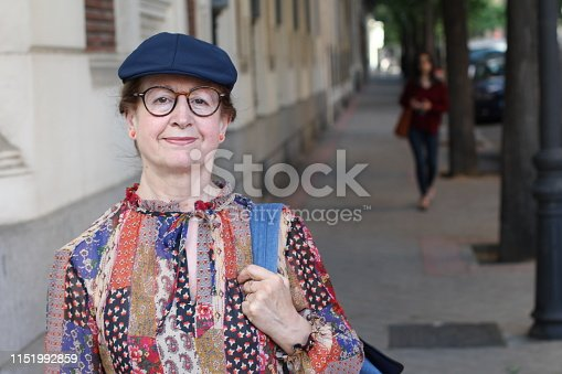 Retro style mature woman outdoors.