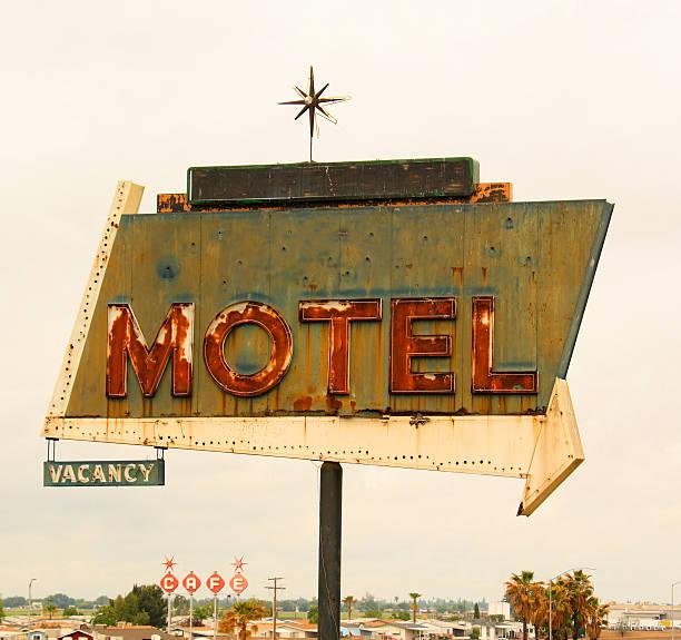 Retro style motel sign with arrow stock photo