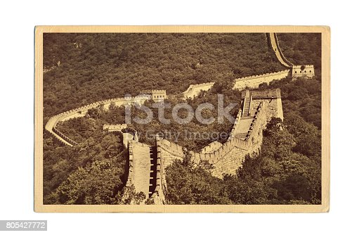 A retro style postcard photo of the scenic view of the Great Wall of China at the Mutianyu location just outside of Beijing, China. The Great Wall of China, a historic site and a very popular international tourist destination.