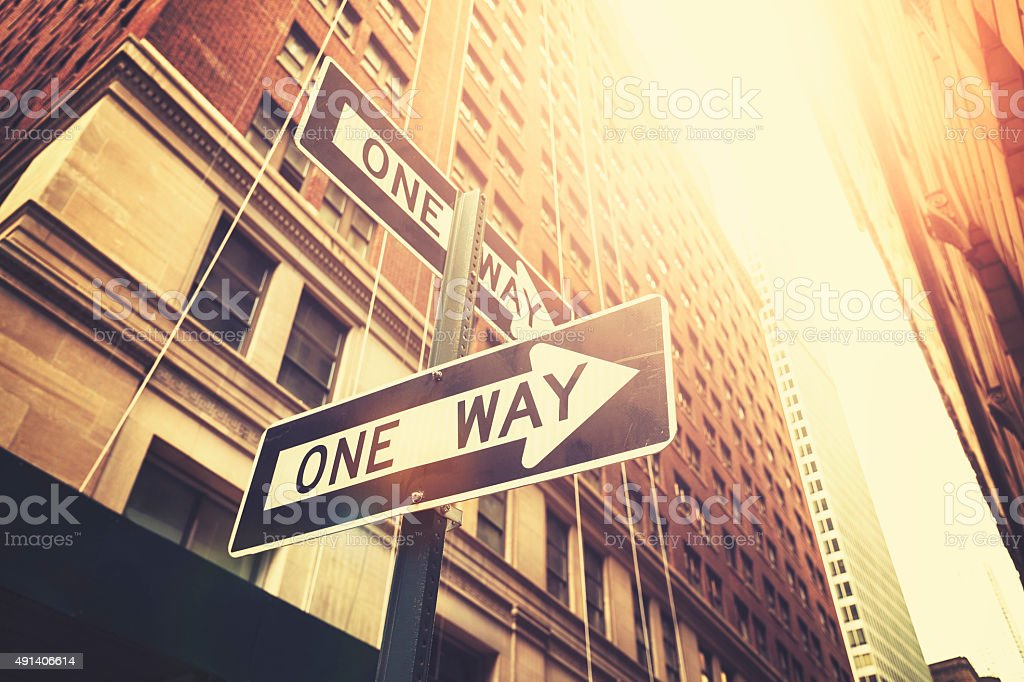Retro style 'one way' signs on street of Manhattan, NYC. stock photo
