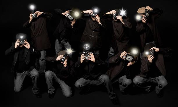 Retro Style Paparazzi Photojournalists stock photo
