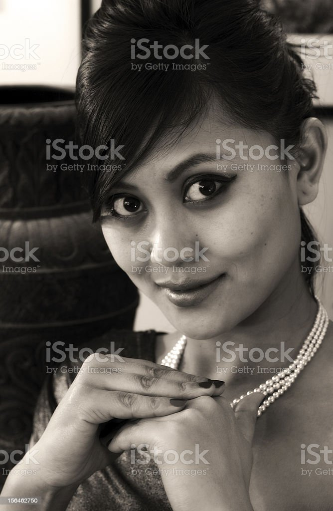 Retro style portrait of a beautiful woman royalty-free stock photo