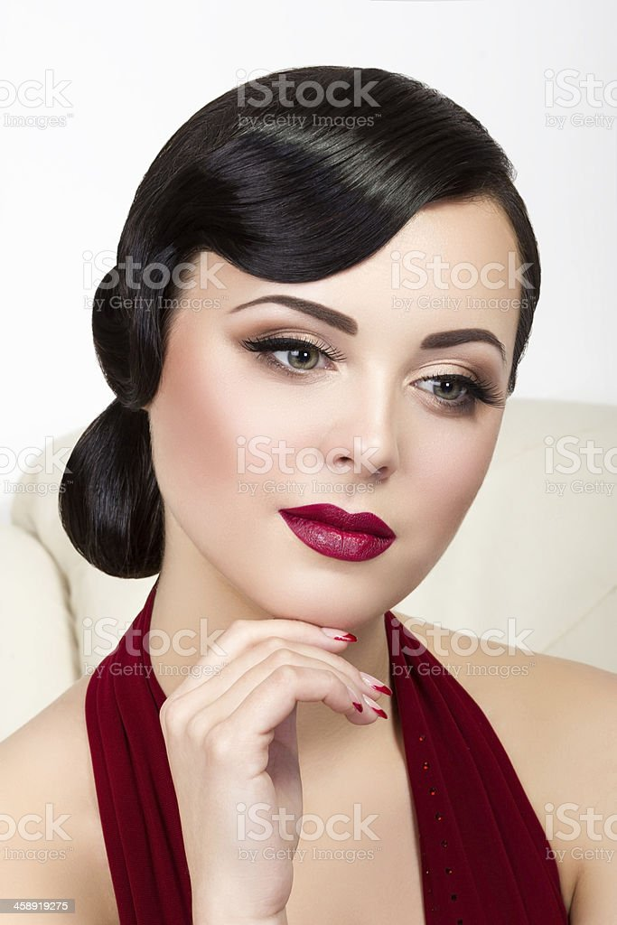 Retro style portrait of thoughtful brunette woman stock photo