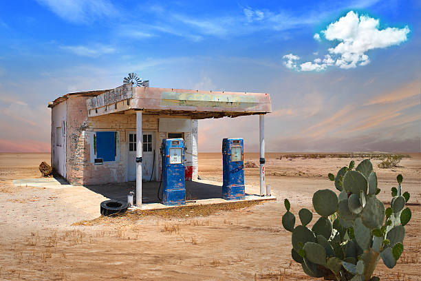 retro style scene of old gas station in arizona desert - western town stock photos and pictures