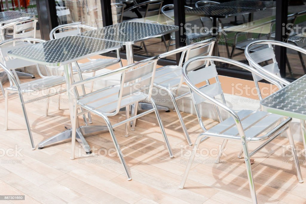 Retro Style Stainless Steel Restaurant Tables And Chairs On An Old City Street Sidewalk In Front Of An Outdoor Cafe Terrace Stock Photo Download Image Now Istock