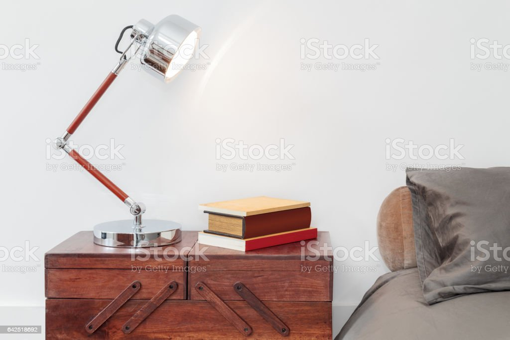Retro Style Table With Lamp And Books stock photo