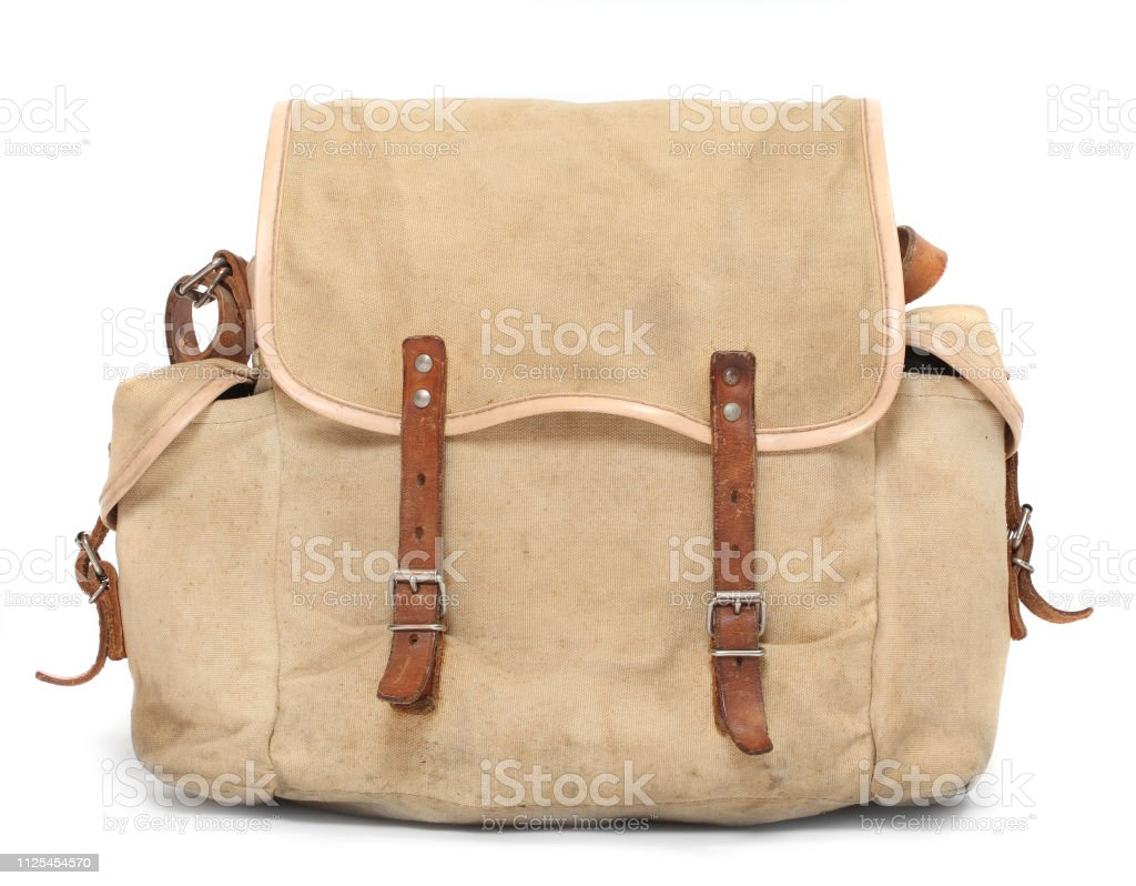 Retro style travel bag or backpack for travelers, fishermens and hunters on white background. stock photo