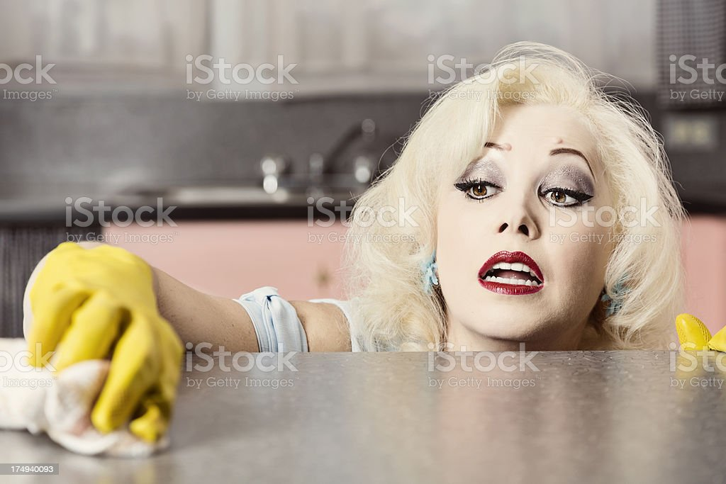 Retro Style Woman Cleaning Kitchen stock photo
