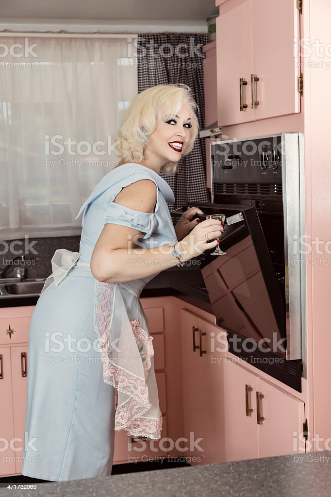 Retro Style Woman in the Kitchen royalty-free stock photo