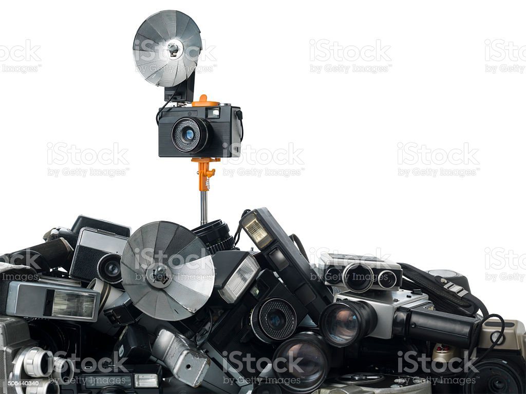 Retro Styled Camera Attached To Selfie Stick On White stock photo
