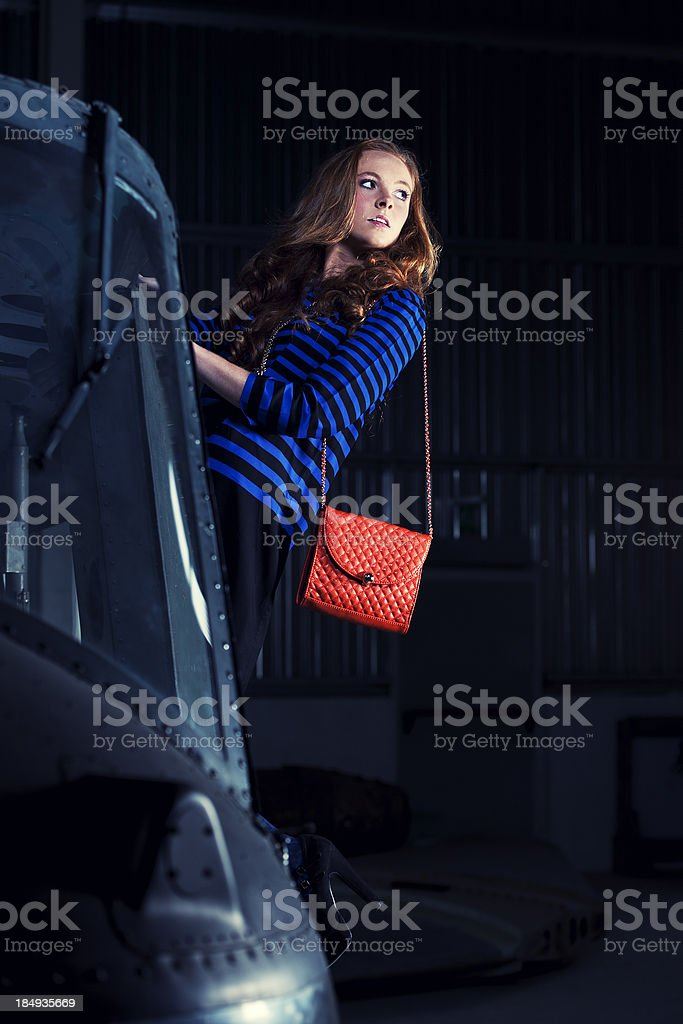 Retro styled fashion model on a helicopter stock photo