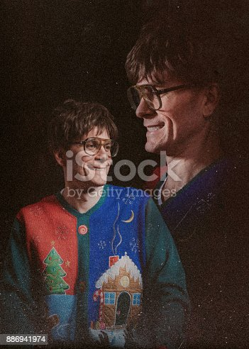 A worn portrait photograph styled after the 1970's and 1980's, with a profile headshot floating above the main subject.  The man wears an ugly Christmas sweater.  A nostalgic throwback to the photo albums of old.
