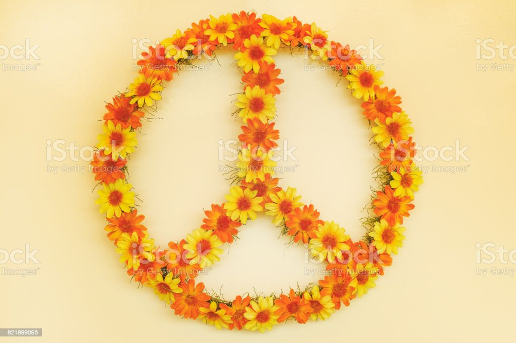 Retro styled image of a seventies flower power peace sign stock photo