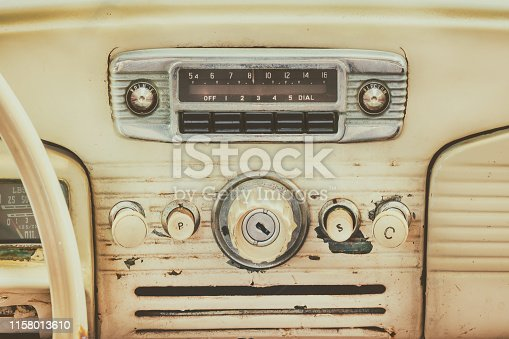 istock Retro styled image of an old car dashboard 1158013610