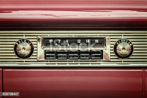 istock Retro styled image of an old car radio 528708447