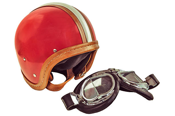 Retro styled image of an old motor helmet with goggles stock photo