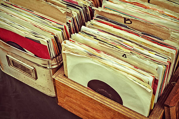 retro styled image of lp records on a flee market - records stock photos and pictures