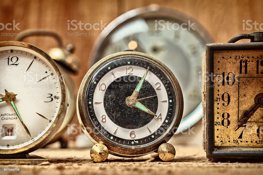 Retro styled image of old alarm clocks stock photo