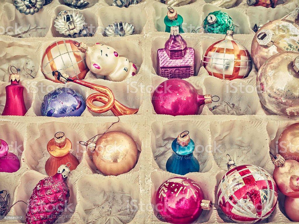 Retro styled image of old Christmas balls stock photo