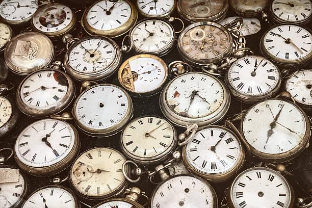Retro styled image of old pocket watches stock photo
