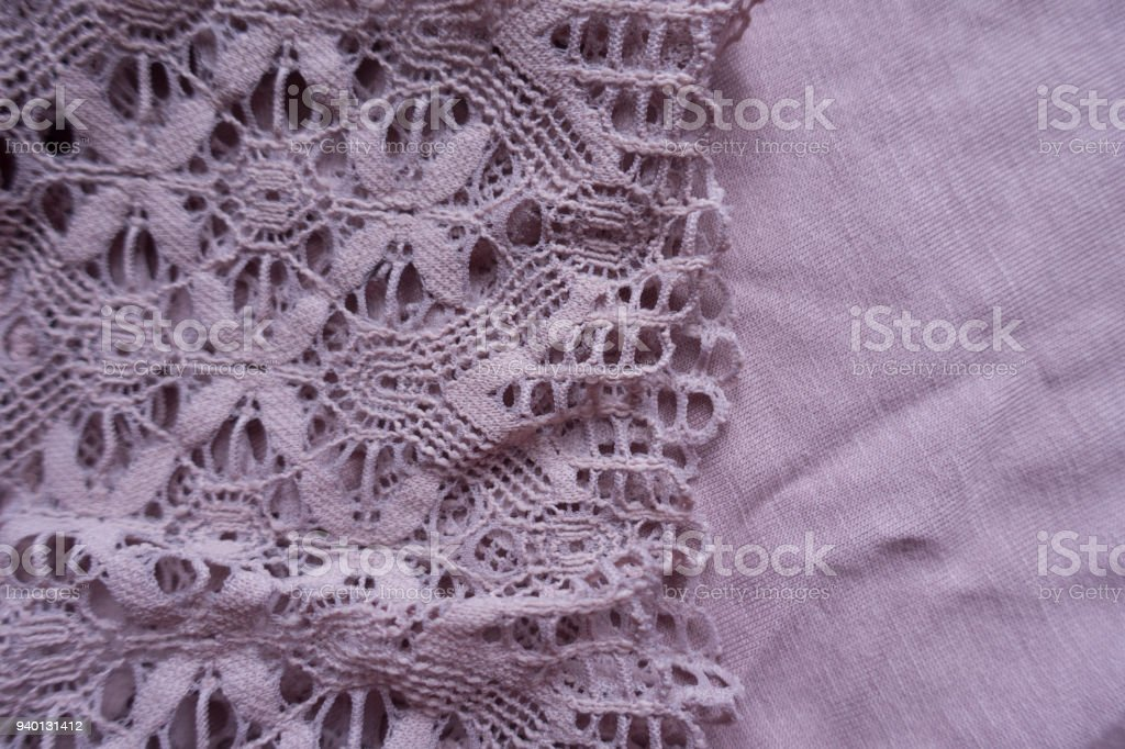 Retro styled lace on simple puce viscose fabric stock photo