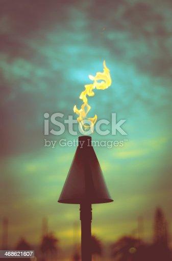 Retro Filtered Vacation Image Of A Hawaiian Tiki Torch At Sunset