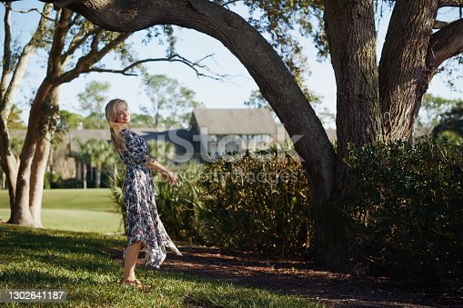 Retro styled woman having fun in the public park