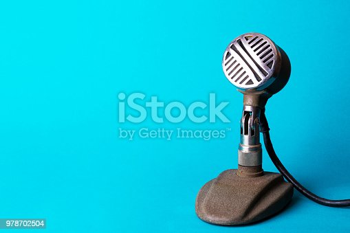 istock retro stylish microphone on a blue background 978702504