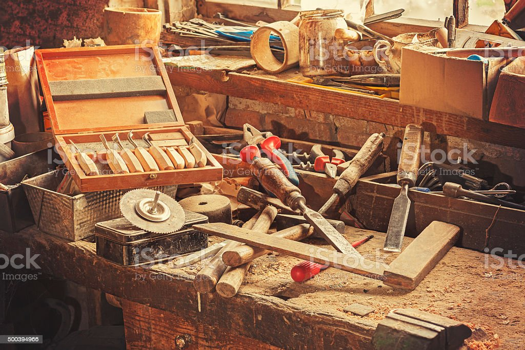 Retro stylized old tools on wooden table in a joinery stock photo