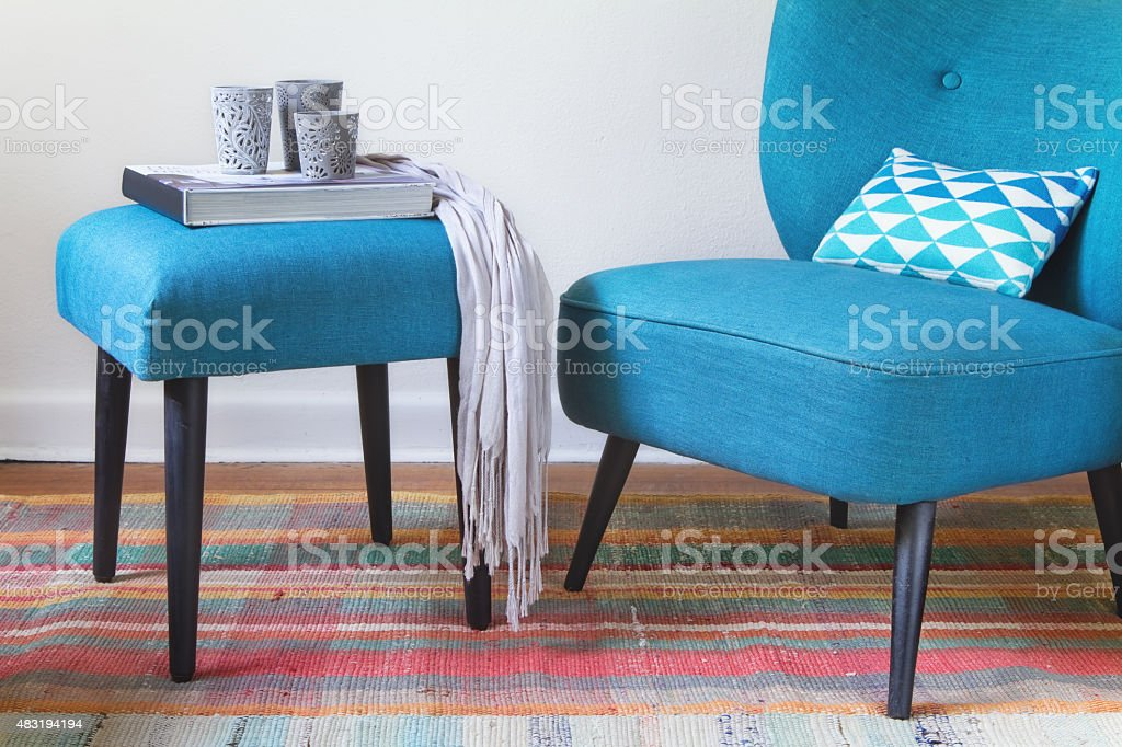 Retro teal armchair and ottoman decor home interior stock photo