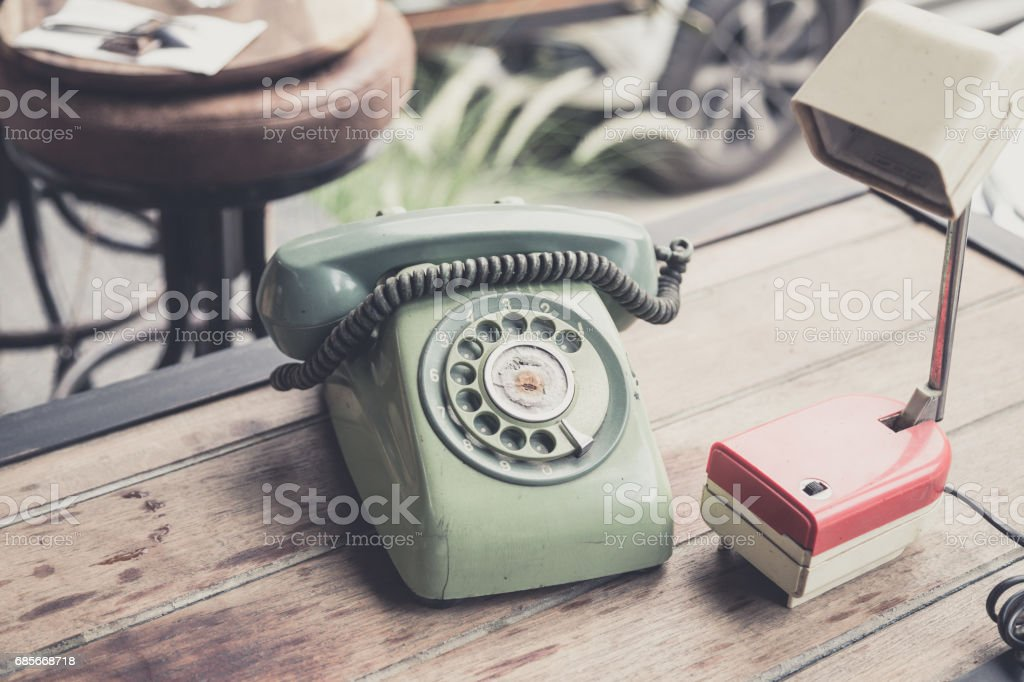 retro telephone and table lamp on wood table ロイヤリティフリーストックフォト