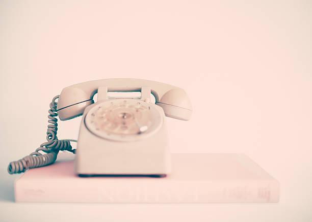 Retro telephone over book stock photo