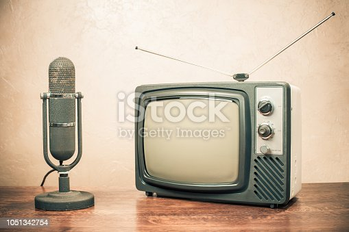 istock Retro television and old microphone from 50s. Vintage instagram style filtered photo 1051342754