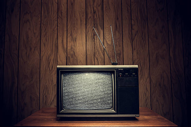 retro television in wood paneled living room - 1980s style stock photos and pictures