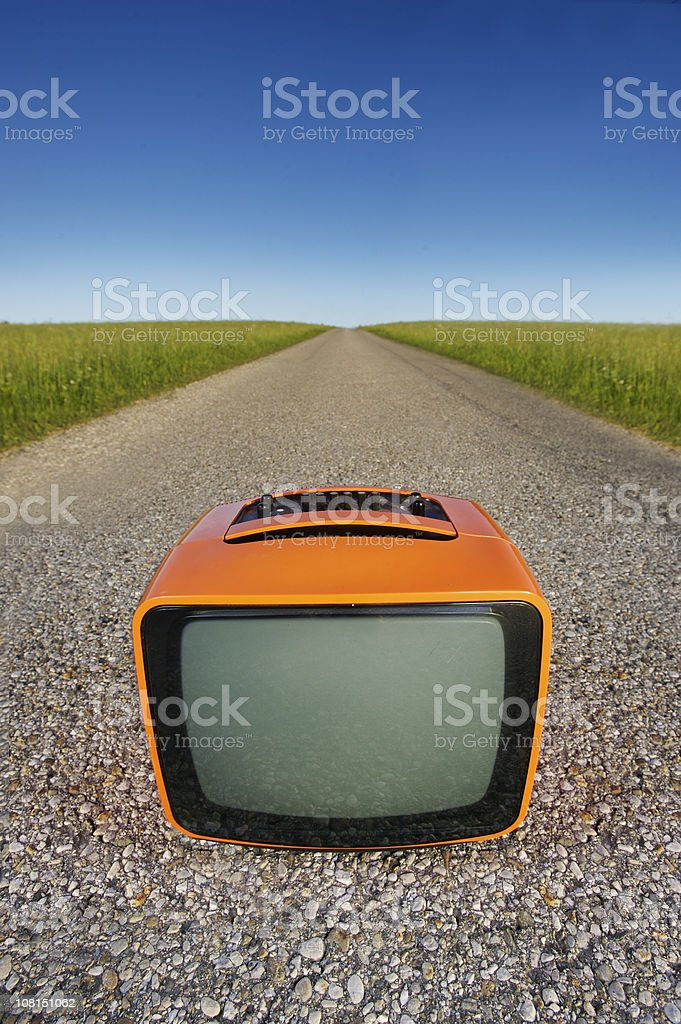 Retro Television on Country Road Against Blue Sky royalty-free stock photo