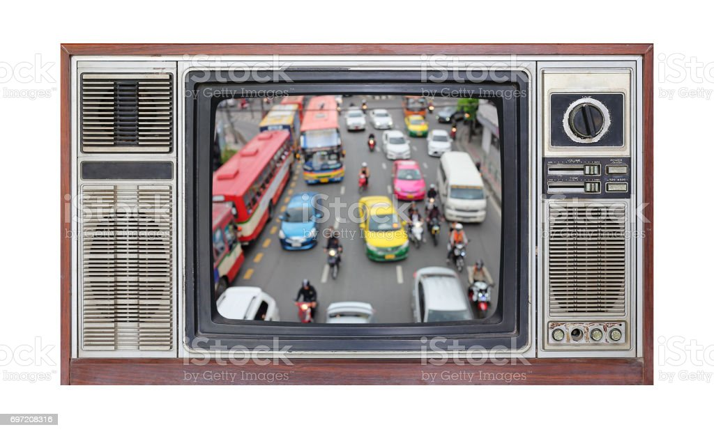 Retro television on white background with blur image of traffic jam on screen. stock photo